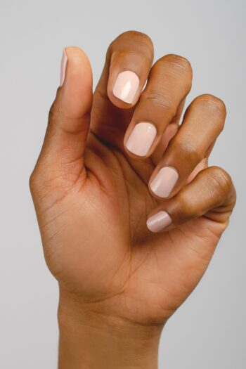 light nude nail polish hand swatch on medium skin tone by sienna