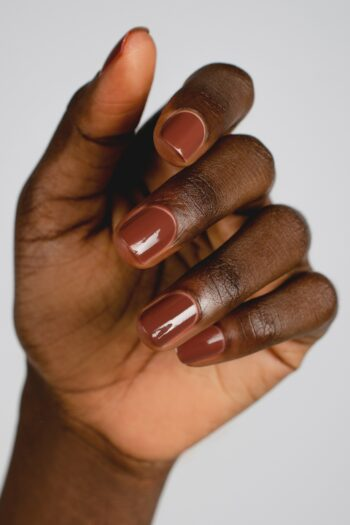 brown nail polish hand swatch on dark skin tone by sienna