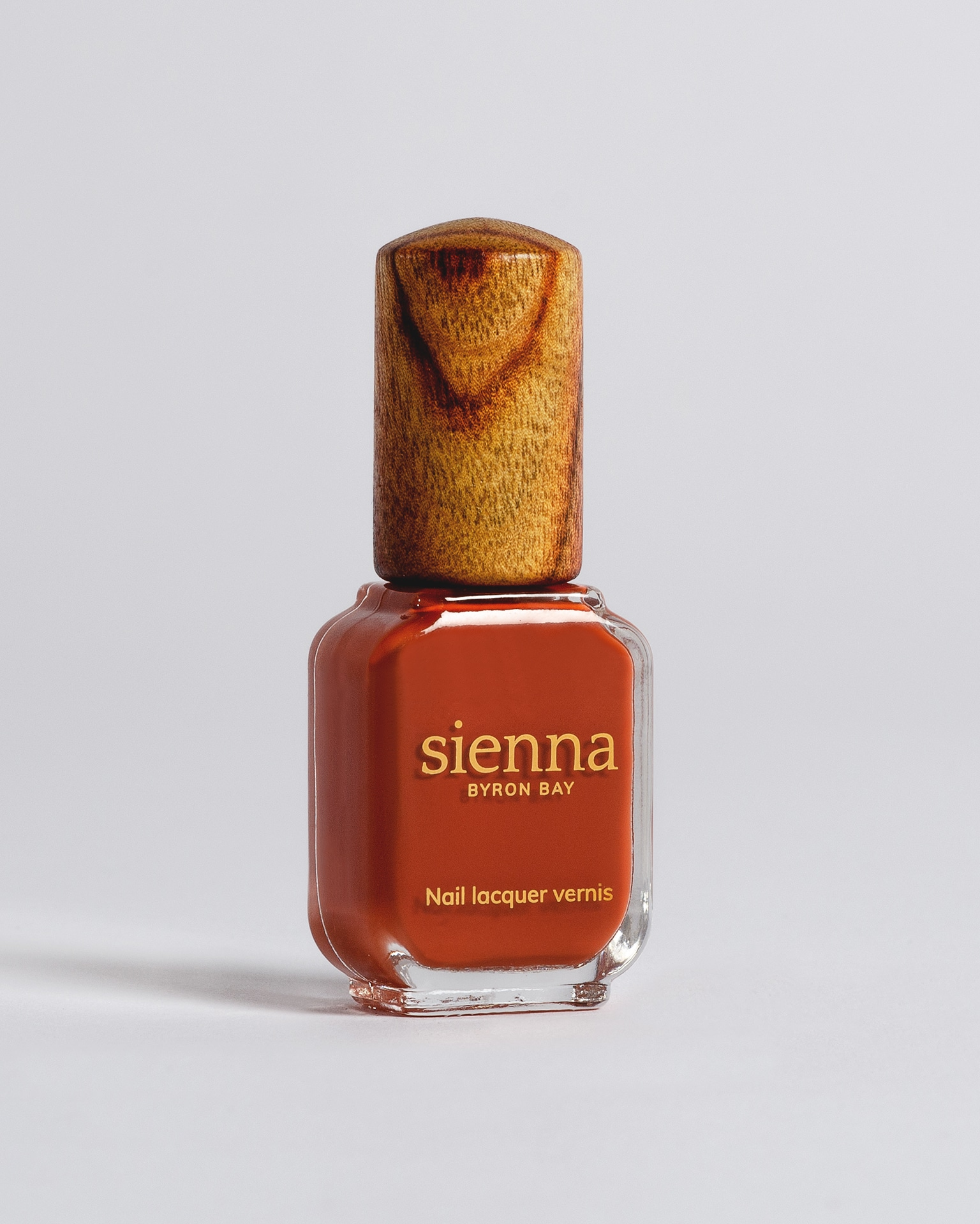 burnt orange nail polish bottle with timber cap by sienna