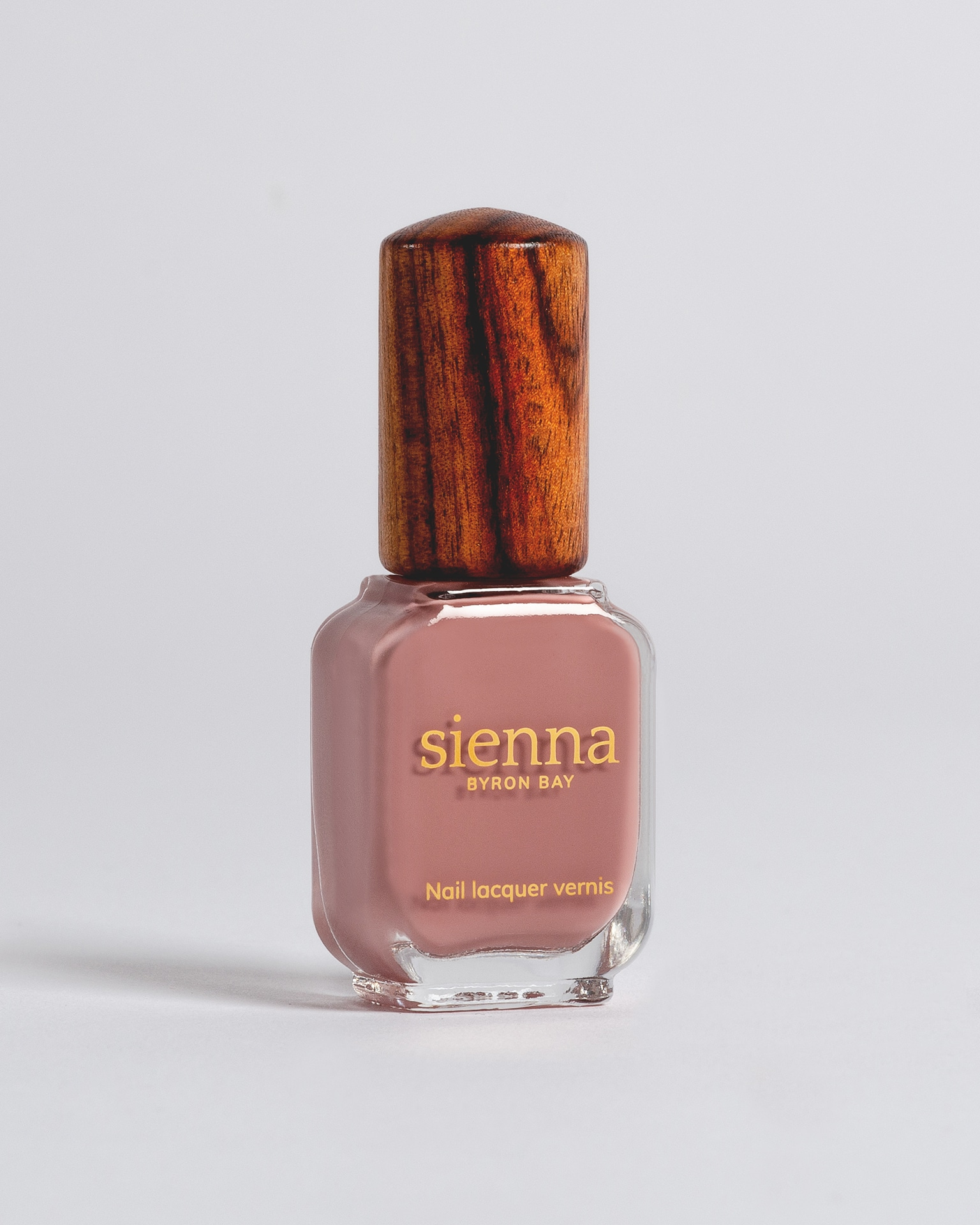 dusty mauve nail polish bottle with timber cap by sienna
