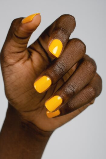 yellow nail polish hand swatch on dark skin tone by sienna