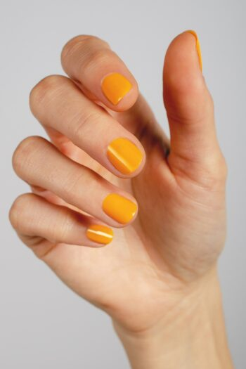 yellow nail polish hand swatch on fair skin tone by sienna
