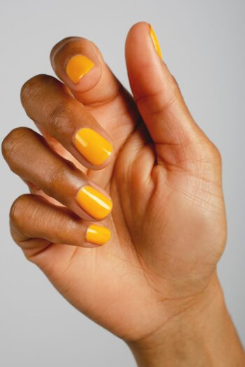 yellow nail polish hand swatch on medium skin tone by sienna