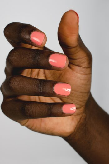 peachy pink nail polish hand swatch on dark skin tone by sienna