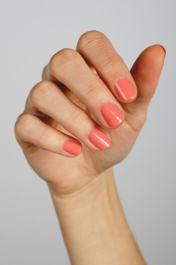 peachy pink nail polish hand swatch on fair skin tone by sienna