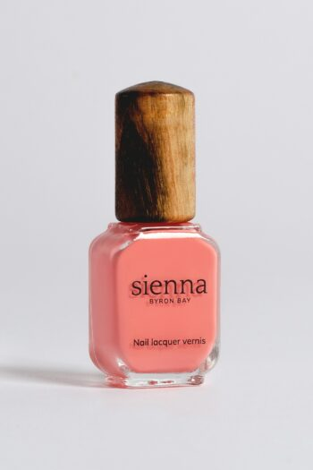 peachy pink nail polish bottle with timber cap by sienna