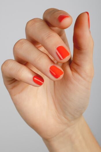 orange nail polish hand swatch on fair skin tone by sienna