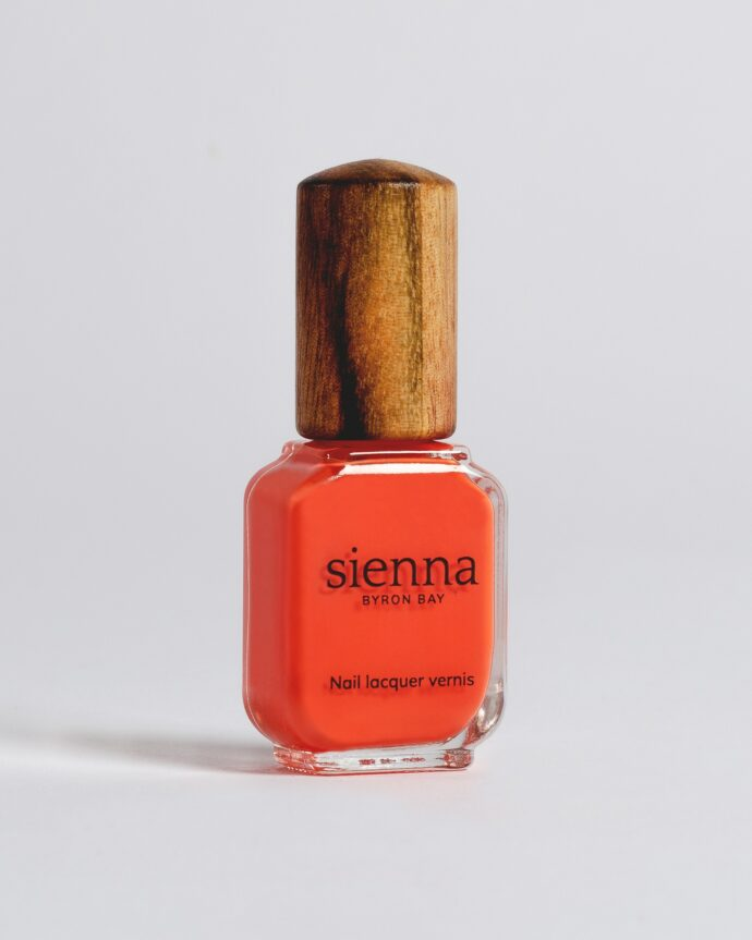 orange nail polish bottle with timber cap by sienna