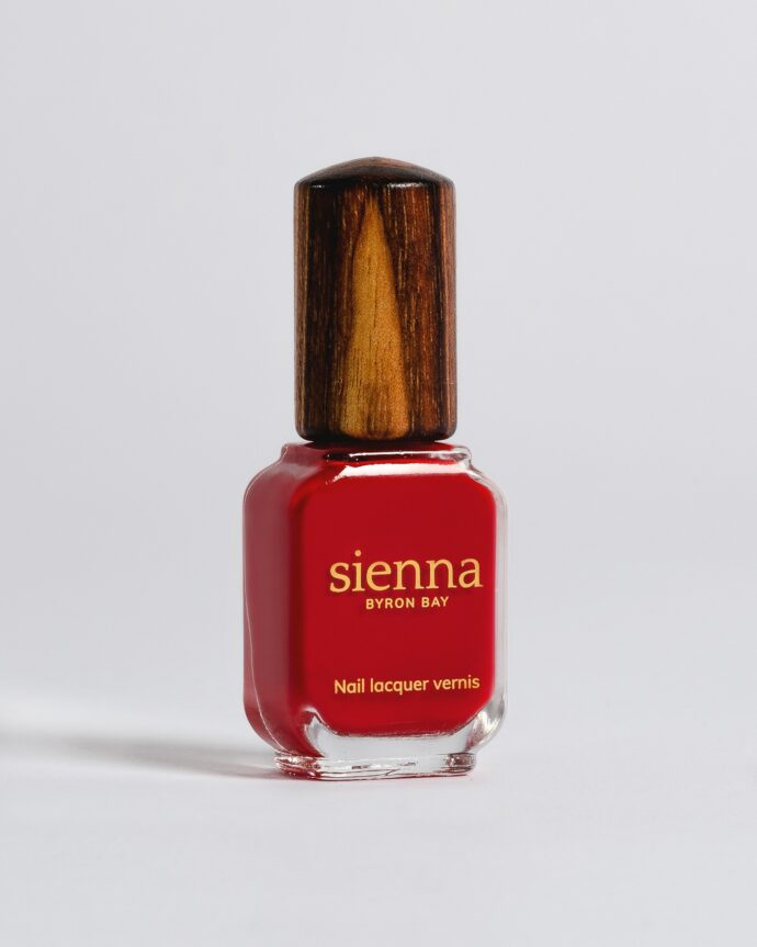 apple red nail polish bottle with timber cap by sienna