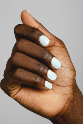 pastel blue nail polish hand swatch on dark skin tone by sienna
