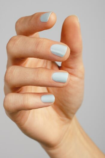 pastel blue nail polish hand swatch on fair skin tone by sienna