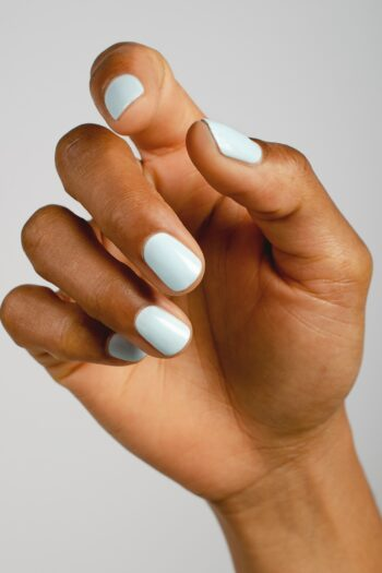 pastel blue nail polish hand swatch on medium skin tone by sienna