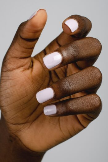 pastel lilac nail polish hand swatch on dark skin tone by sienna