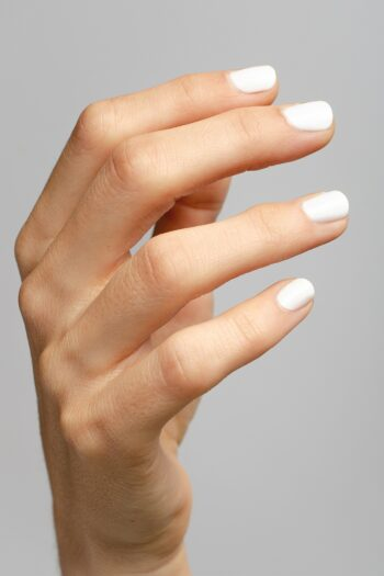white nail polish hand swatch on fair skin tone by sienna