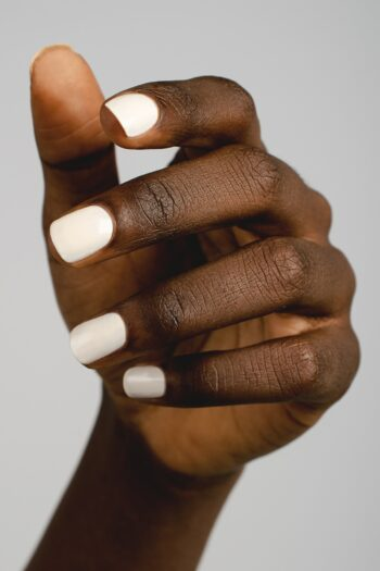 eggshell white nail polish hand swatch on dark skin tone by sienna