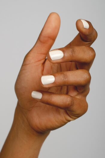 eggshell white nail polish hand swatch on medium skin tone by sienna