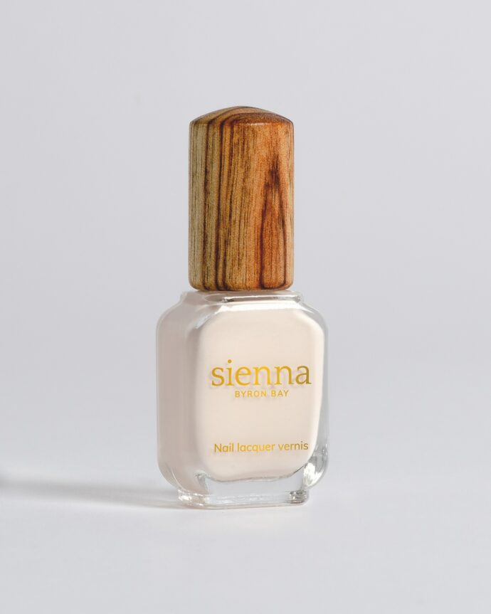eggshell white nail polish bottle with timber cap by sienna