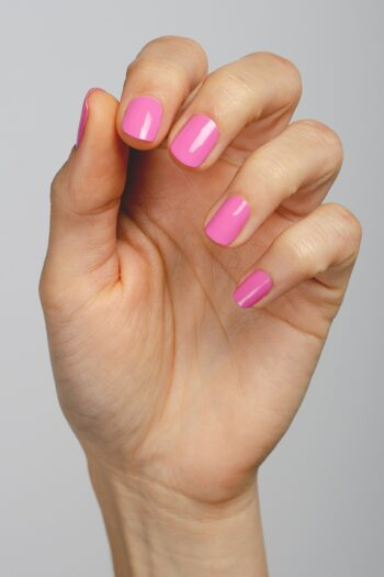 bright fuchsia nail polish hand swatch on fair skin tone by sienna