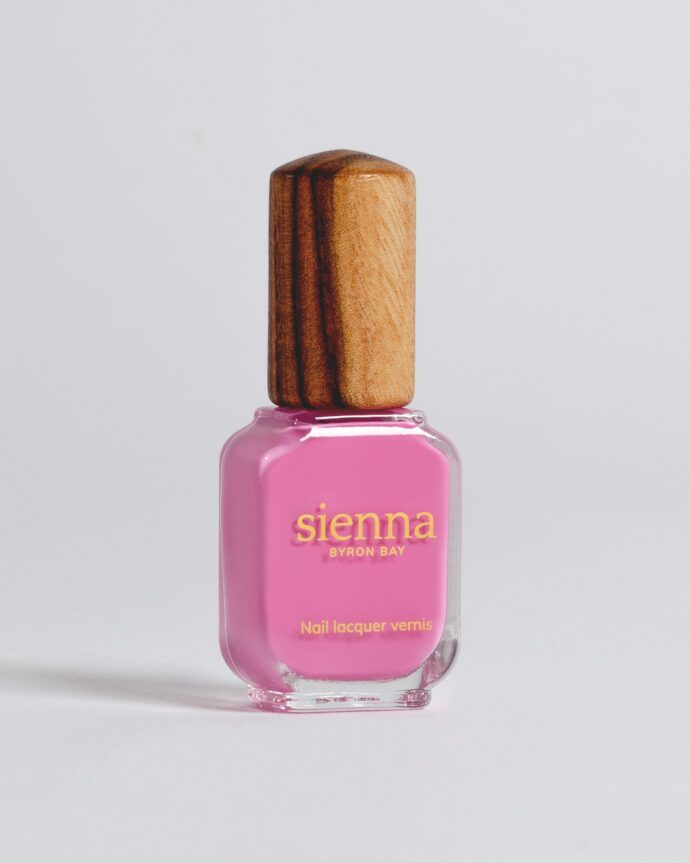 bright fuchsia nail polish bottle with timber cap by sienna