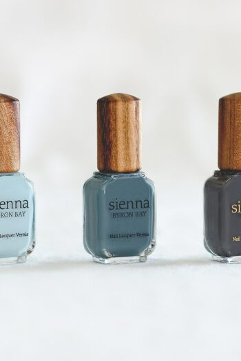 3 blue nail polish in glass bottle with timber cap by sienna