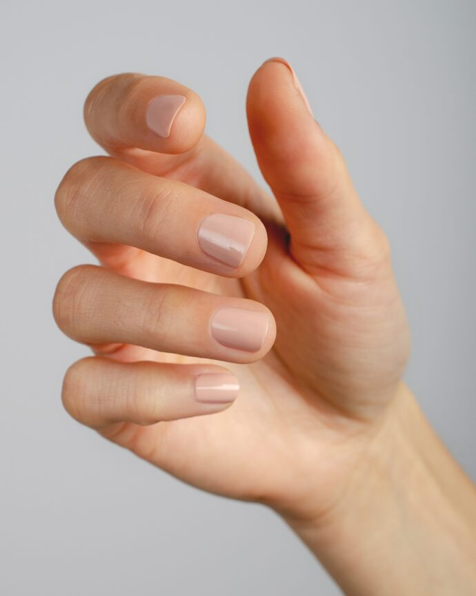 nude pink nail polish hand swatch on fair skin tone by sienna