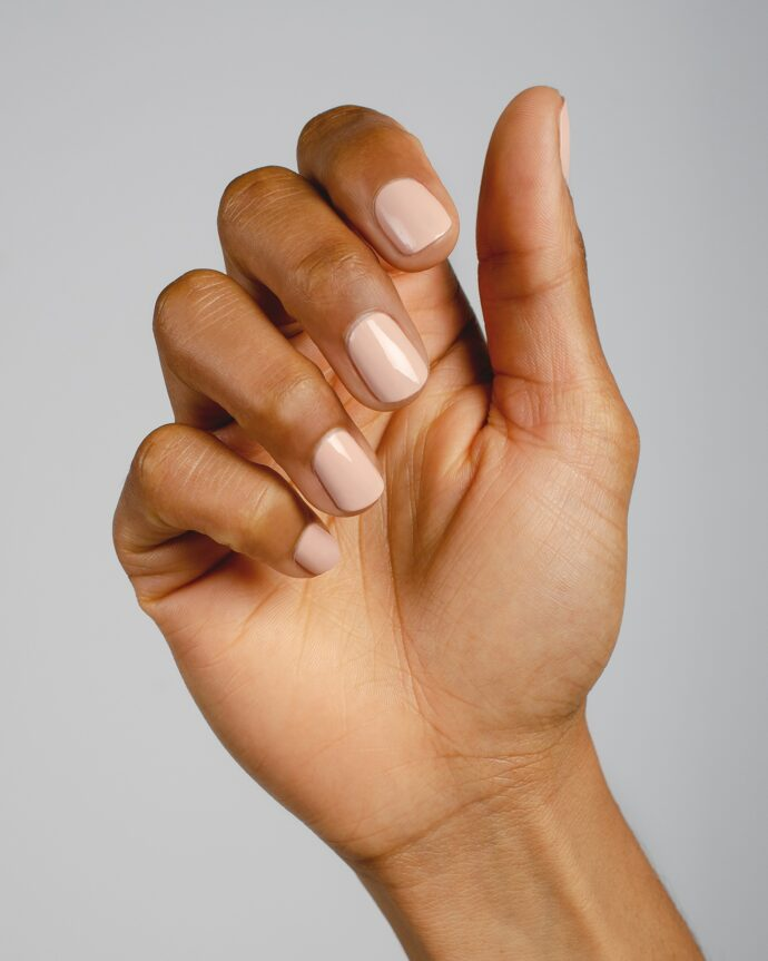 nude pink nail polish hand swatch on medium skin tone by sienna
