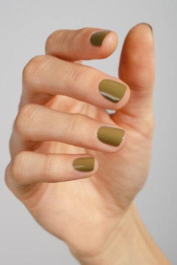 kaki green nail polish hand swatch on fair skin tone by sienna