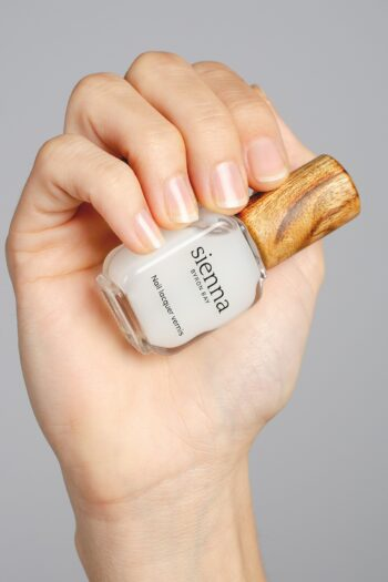 nail strengthener hand swatch on fair skin tone by sienna