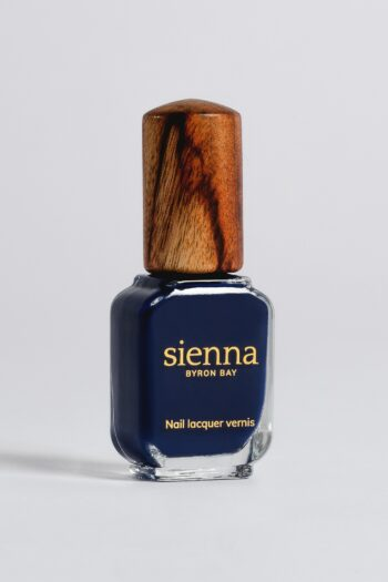 dark navy blue nail polish bottle with timber cap by sienna