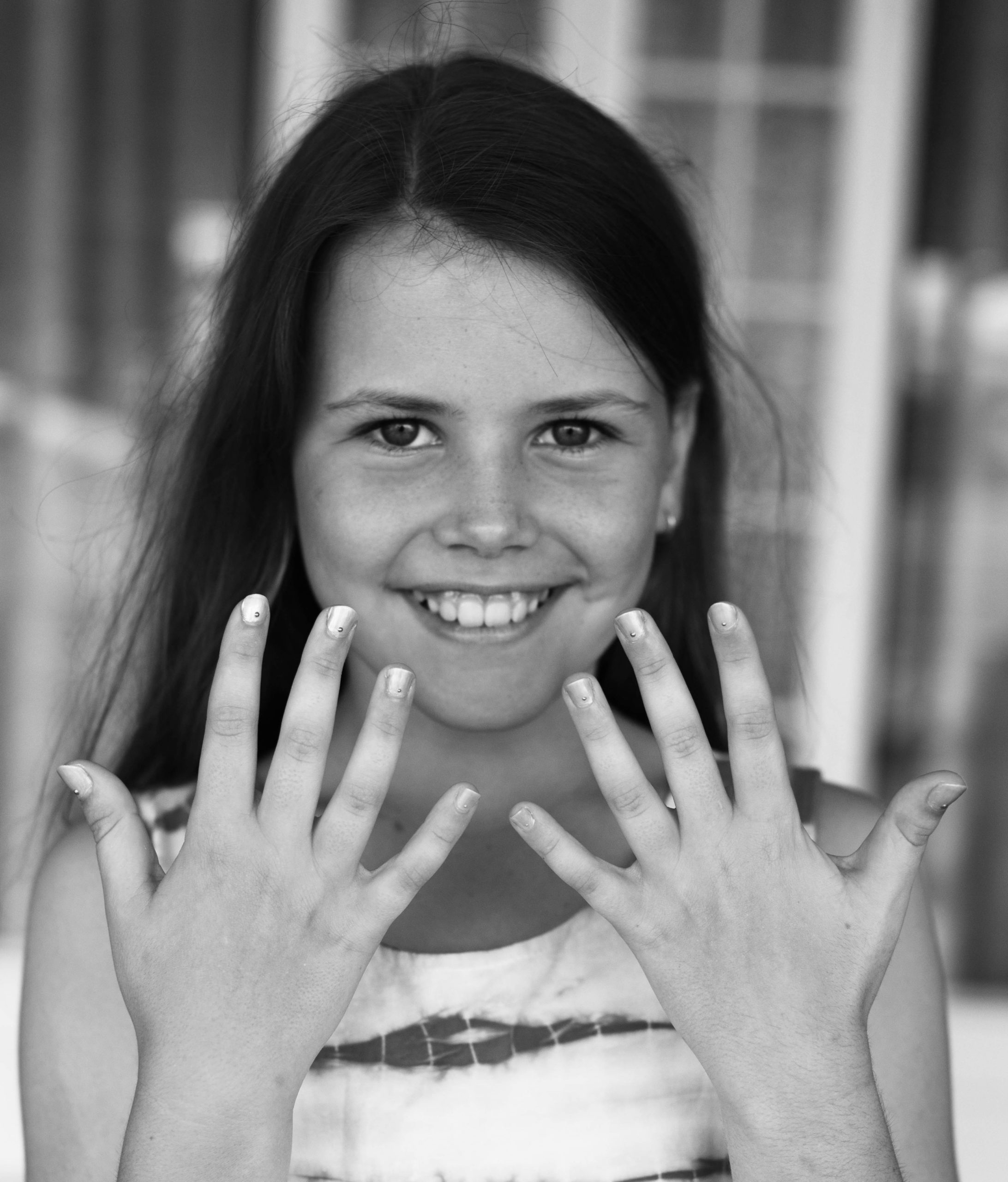 future dreamer black and white photo of a little girl wearing nail polish by sienna