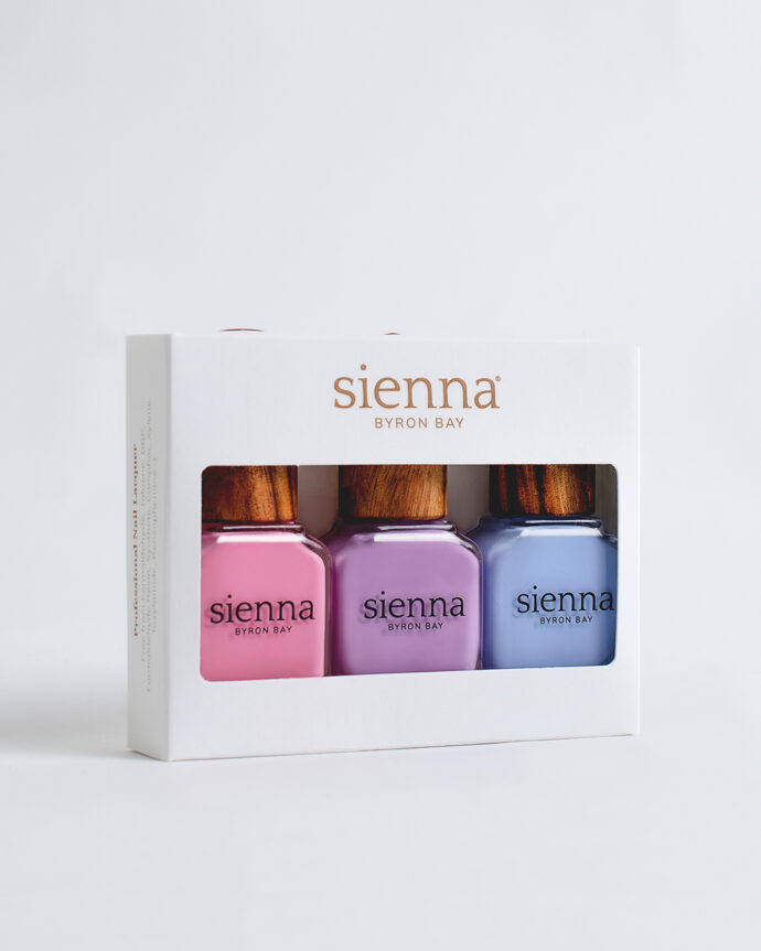 pastel pink purple and blue nail polish bottles with timber cap in white carboard box by sienna