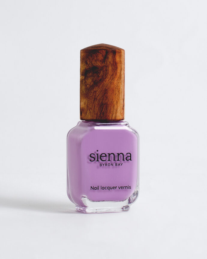 mid-tone lilac nail polish bottle with timber cap by sienna