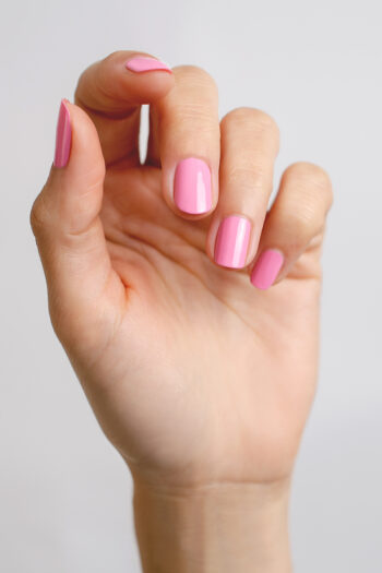 Classic pink nail polish hand swatch on fair skin tone by sienna