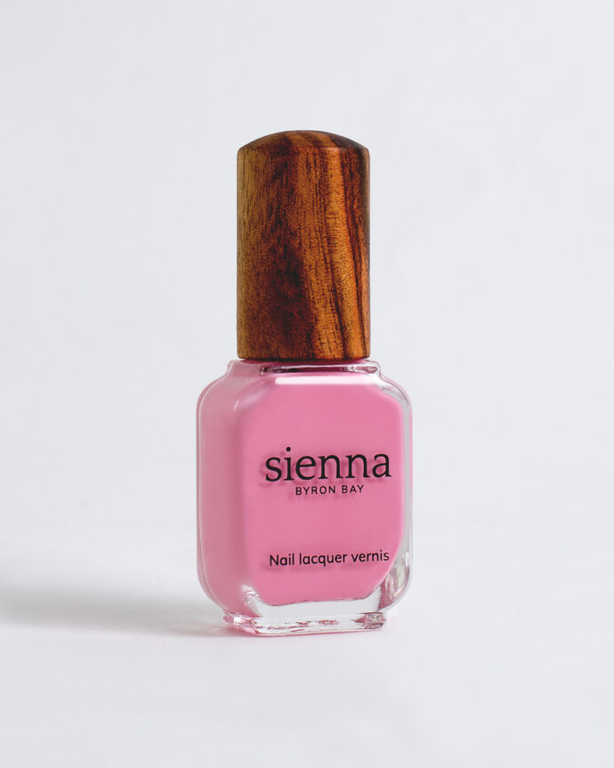 classic pink nail polish bottle with timber cap by sienna
