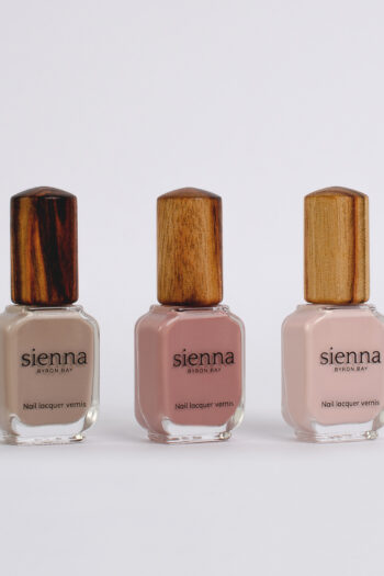 nude and dusty pink nail polish bottles with timber cap by sienna