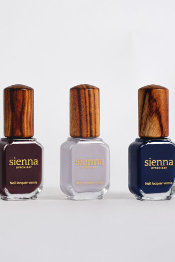 Dark purple light purple and and dark blue nail polish bottle with timber cap by sienna